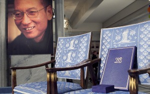 The empty chair with a diploma and medal that should have been awarded to this year's Nobel Peace Prize winner Liu Xiaobo (portrait l) stands in  Oslo City Hall on December 10, 2010. The head of the Nobel committee placed this year's peace prize on an empty chair  as Beijing raged against the award to dissident Liu Xiaobo, who is languishing in a Chinese prison cell. AFP Photo : Heiko Junge / SCANPIX NORWAY (Photo credit should read Junge, Heiko/AFP/Getty Images)