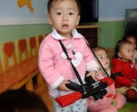 nrth korean toddler with machine gun